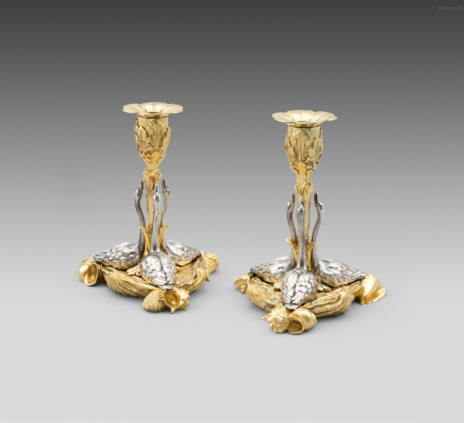 An Exceptional Pair of William IV Swan Candlesticks