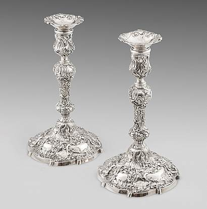 A Pair of Superb Rococo Candlesticks