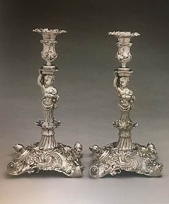 A Highly Important Pair of Figural Candelsticks