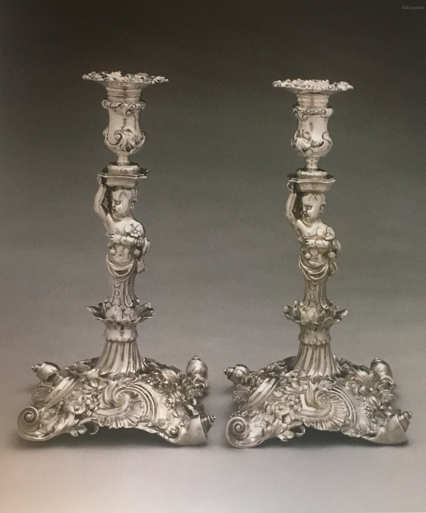 A HIGHLY IMPORTANT PAIR OF GEORGE II SILVER CANDLESTICKS