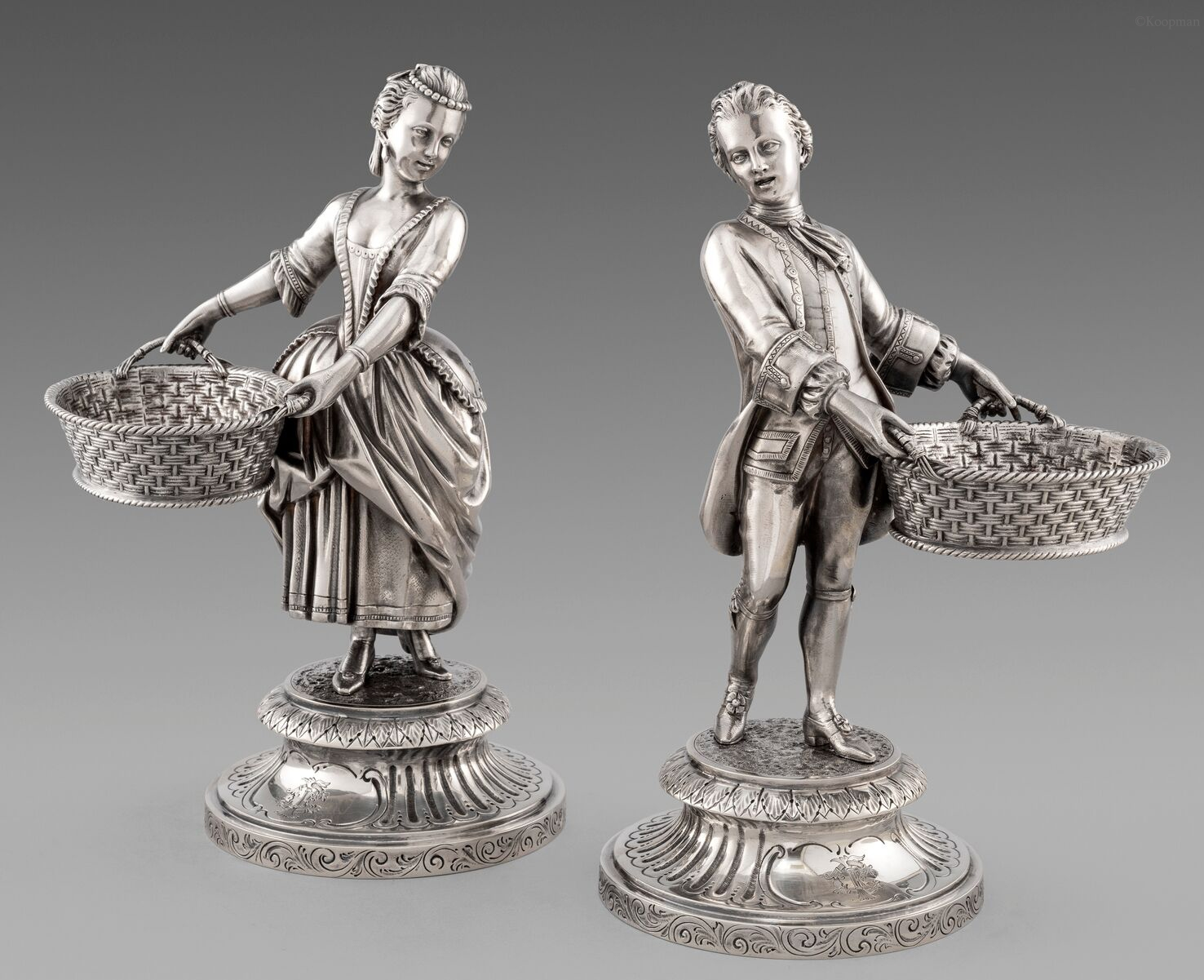 A Pair of Large Figural Salt Cellars in 18th Century Costume
