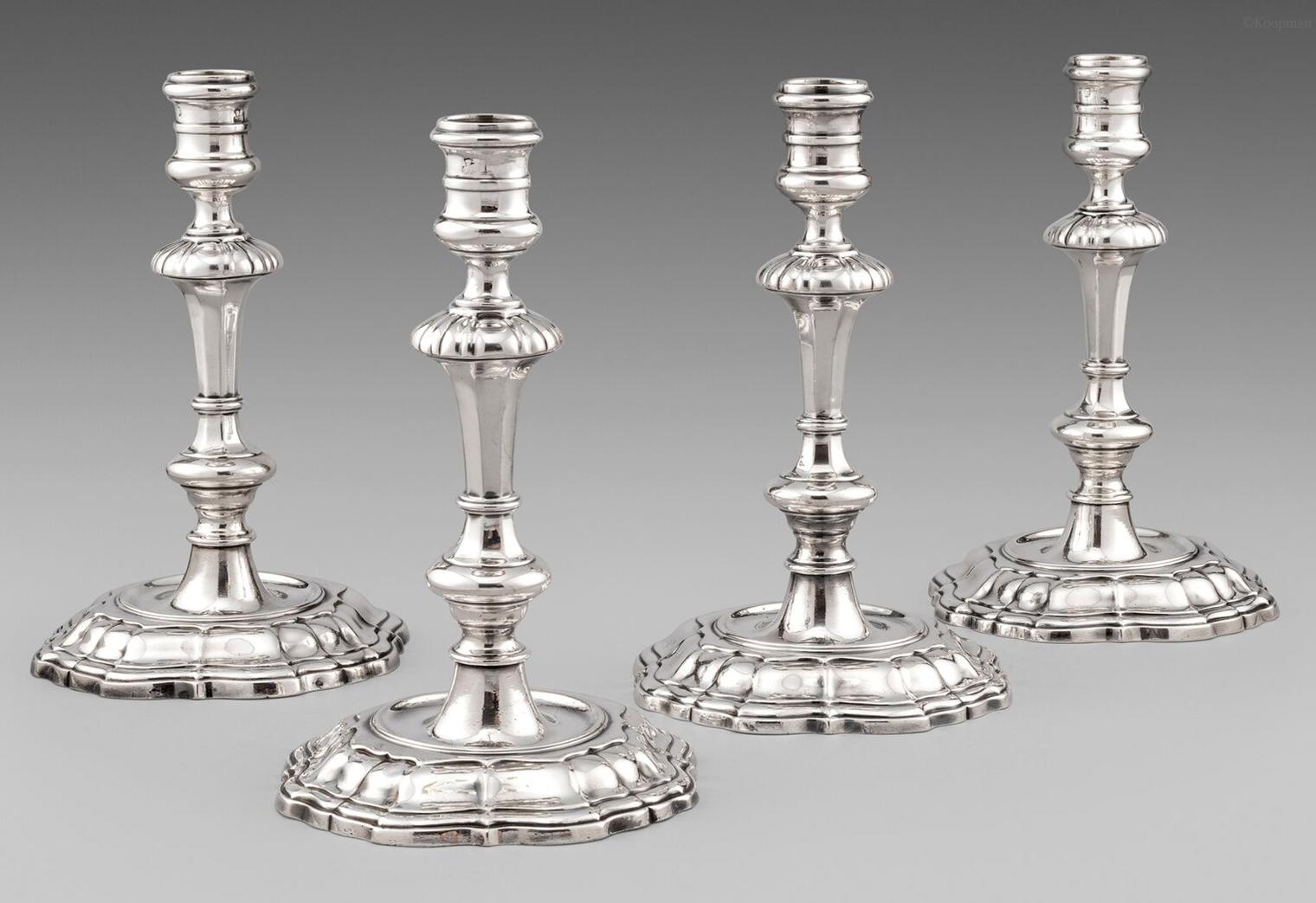 A Set of Four George II Candlesticks