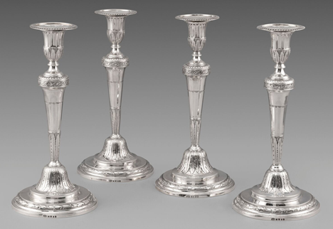 A Set of Four George III Neo-Classical Candlesticks