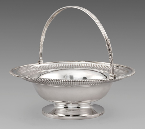 A George III Circular Swing-Handled Cake Basket