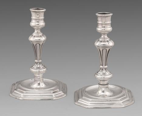 A Pair of Queen Anne Candlesticks
