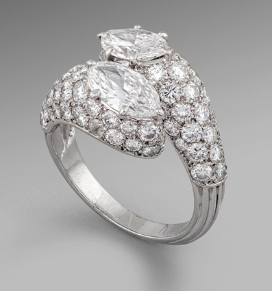 A Two Stone Marquise Diamond Crossover Cluster Ring