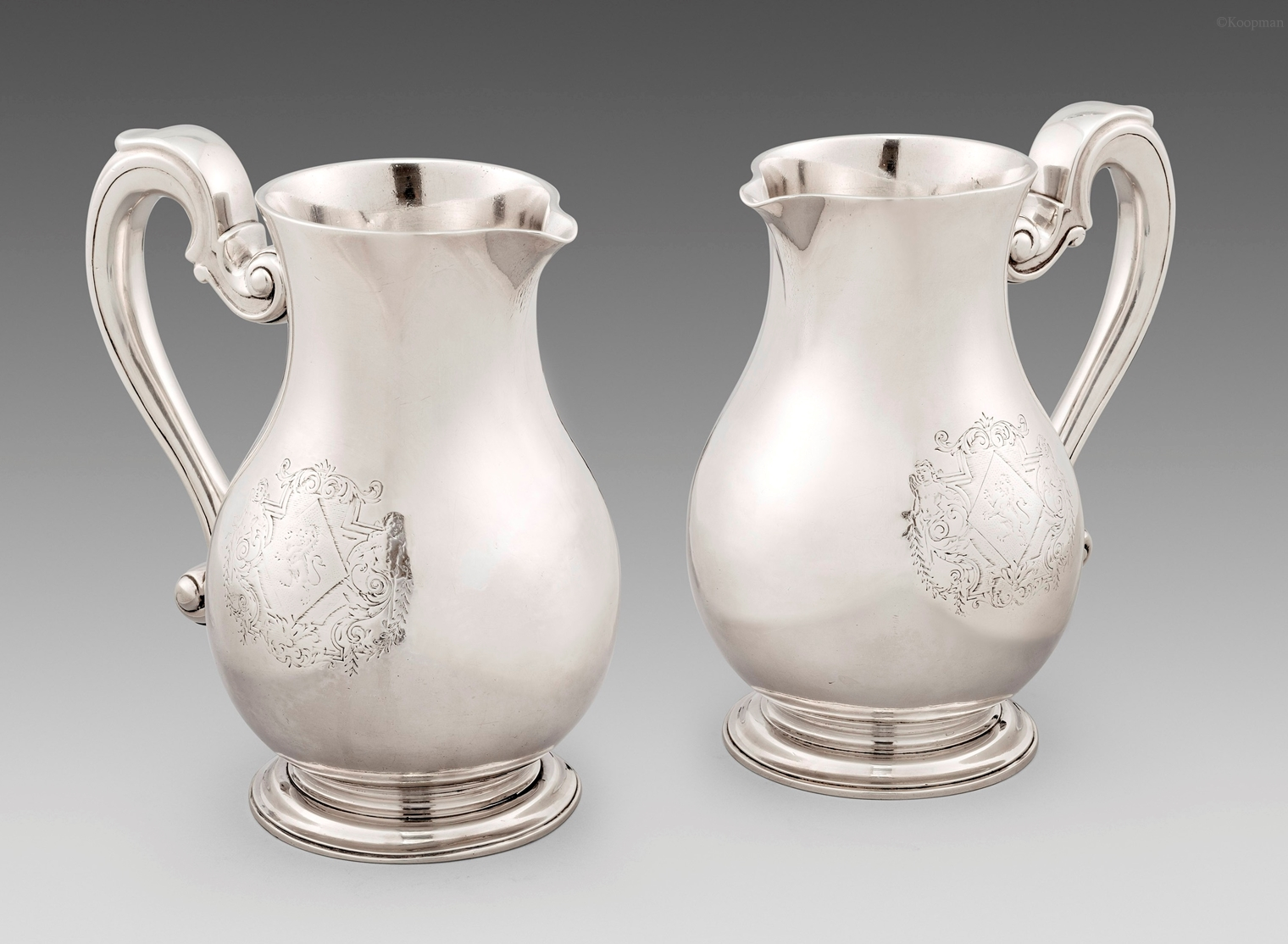 An Extremely Rare Pair of George I Beer Jugs