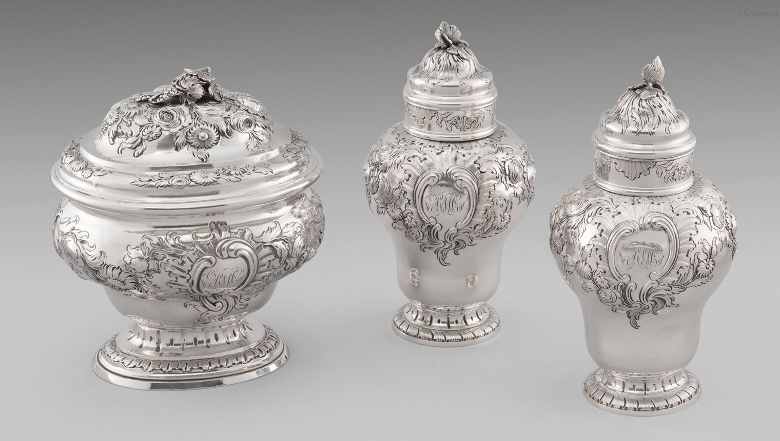 A set of Three George II Tea Caddies in a Fitted Box
