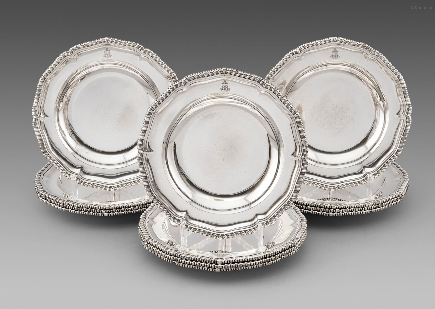 A set of twelve George IV soup plates