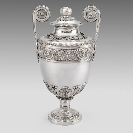 A Twin Handled Urn and Cover