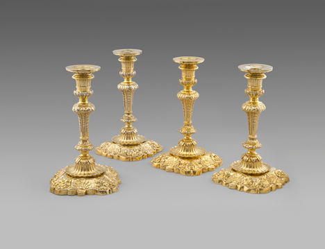 An Important Set of Four Silver-Gilt George III Royal Candlesticks