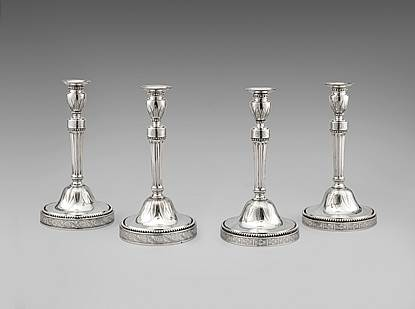 A Set of Four Dutch Candlesticks