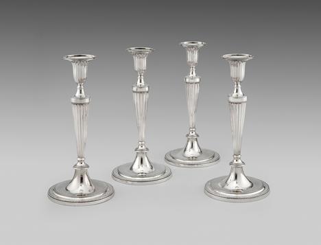 A Set of Four Round Base Candlesticks