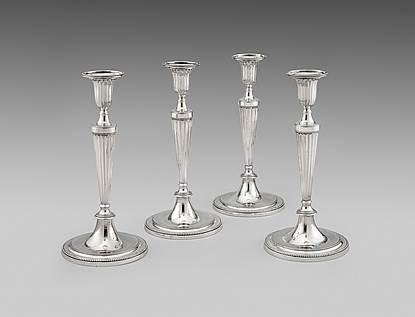 A Set of 4 George III Candlesticks