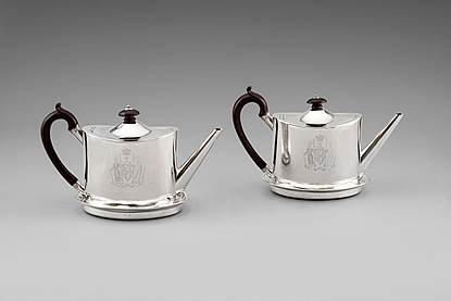 A Pair of George III Teapots on Stands