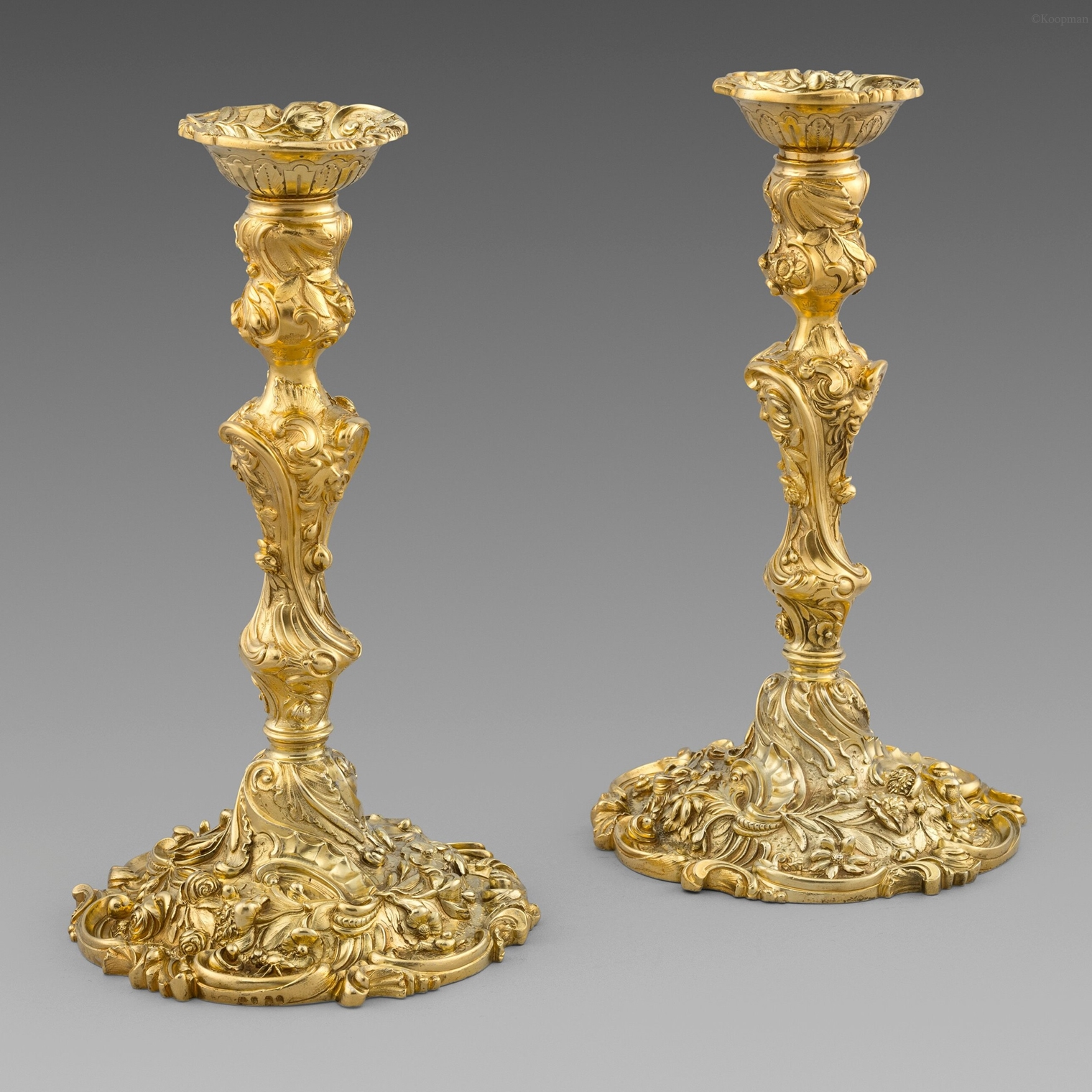 A Superb Pair of Rococo-Revival Candlesticks