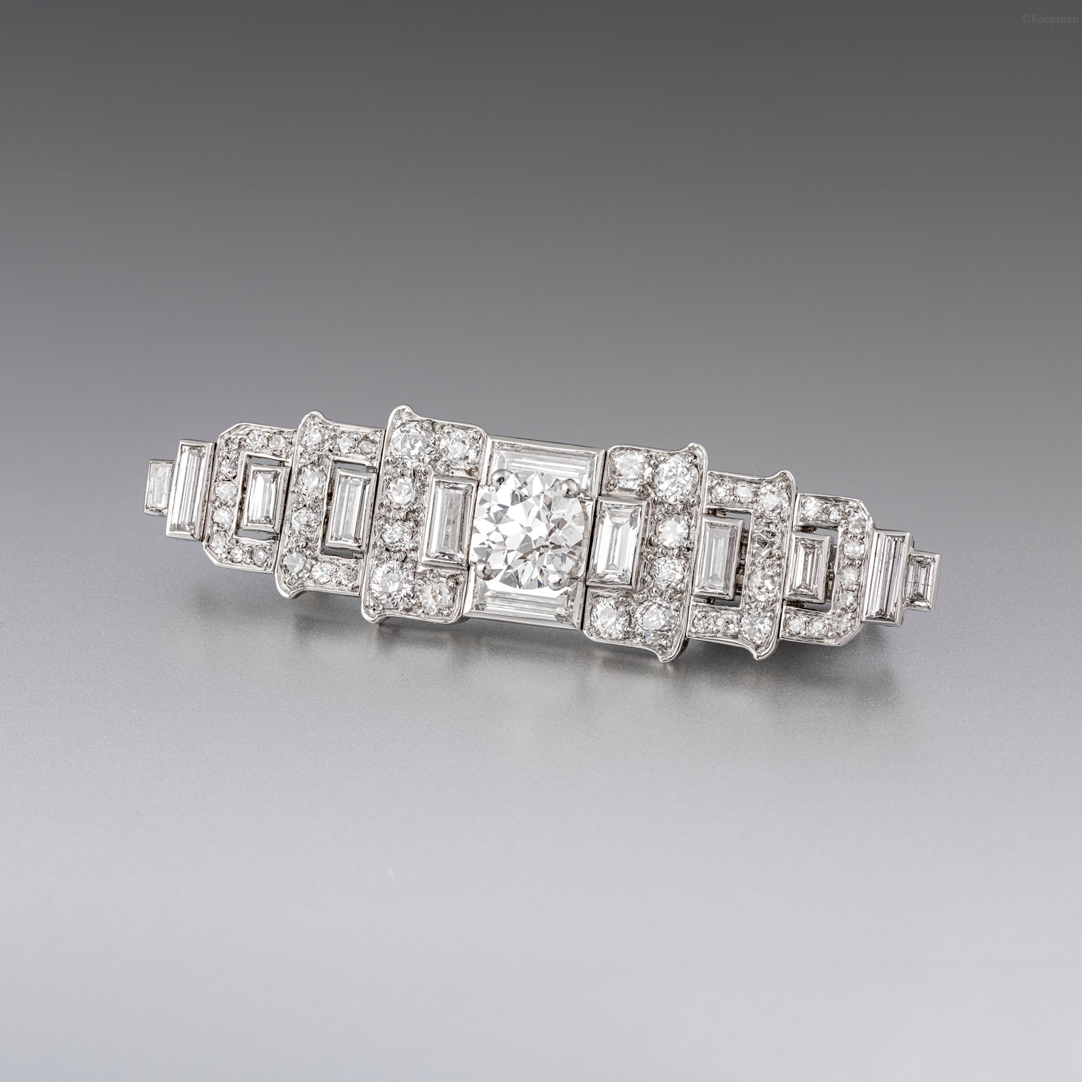 An Art Deco Diamond Set Bar Brooch by Cartier