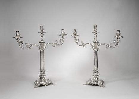 A pair of William IV silver two-light candelabra