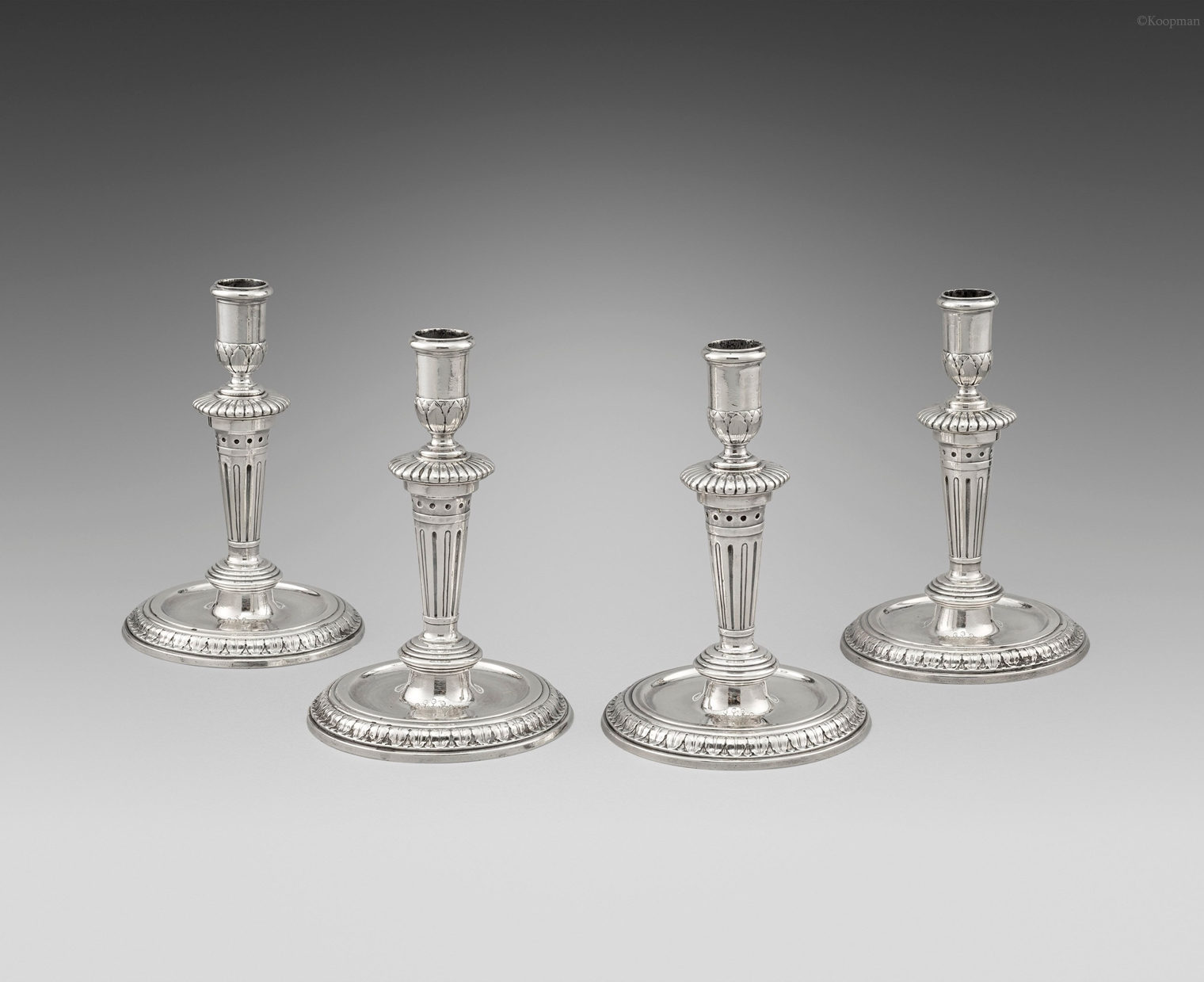 A Set of Four Queen Anne Candlesticks