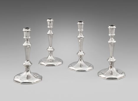 A Set of Four Britannia Candlesticks