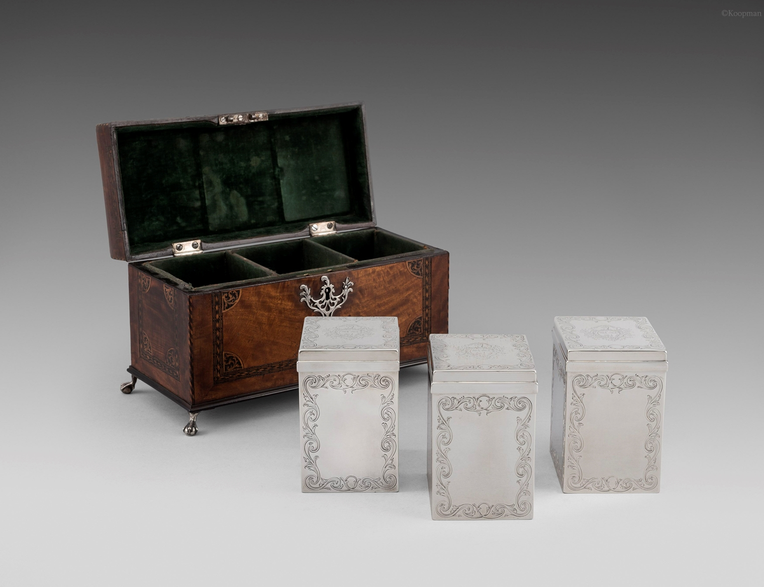 A Set of Three George III Tea Caddies in a Fitted Box