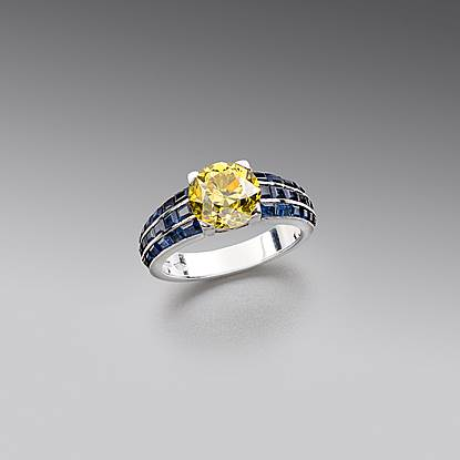 A Fancy Vivid Yellow Diamond and Sapphire Ring