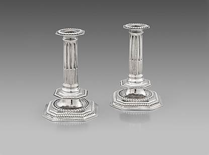 A Pair of William III Candlesticks