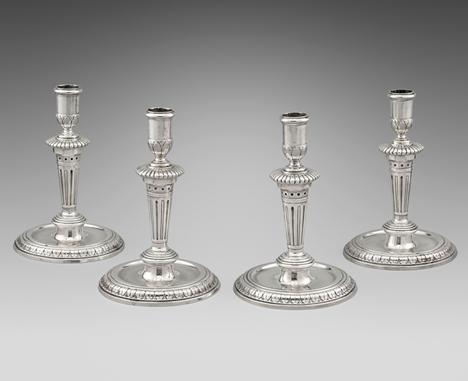 An Elegant Set of Four Round Base Candlesticks