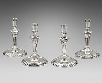An Elegant Set of Four Round Base Candlesticks