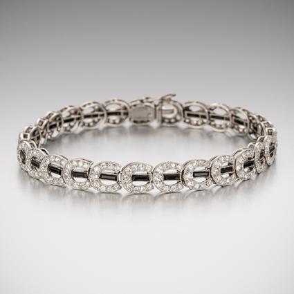 A Diamond and Onyx Horseshoe Bracelet