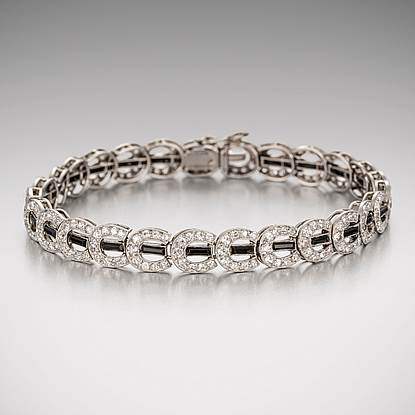A Diamond and Onyx Horseshoe Bracelet