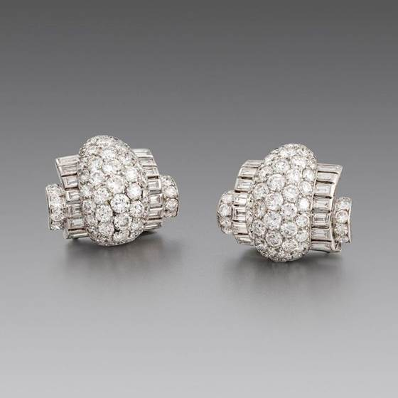 A Pair of Stylish Art Deco Diamond Clip Brooches and Bangle