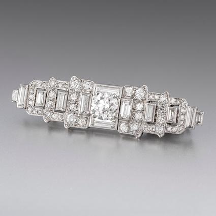 An Art Deco Diamond Set Bar Brooch by Cartier