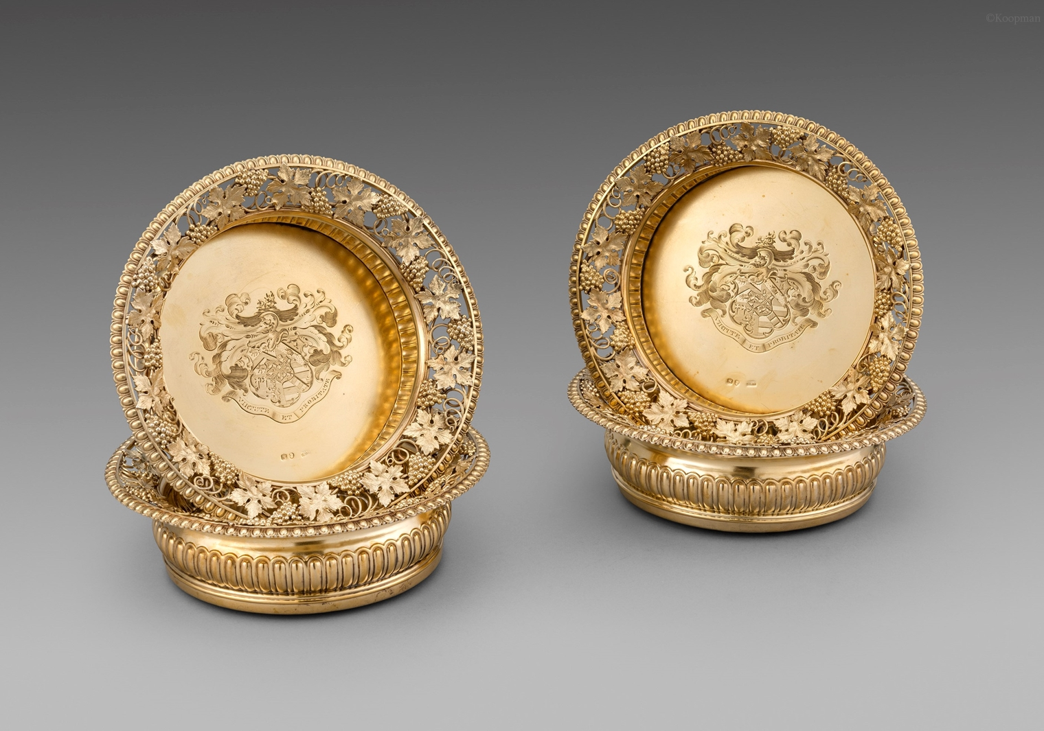A Set of Four George III Wine Coasters
