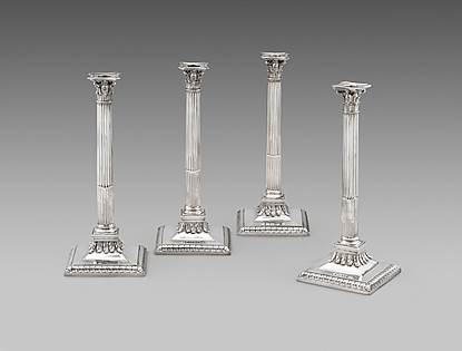 A Splendid Set of Four Corinthian Column Candlesticks