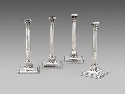 A Splendid Set of Four Corinthian Column Candlesticks