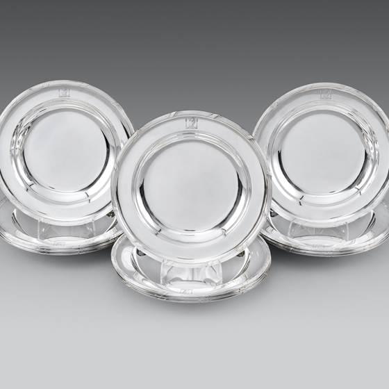 A Set of Twelve Soup Plates