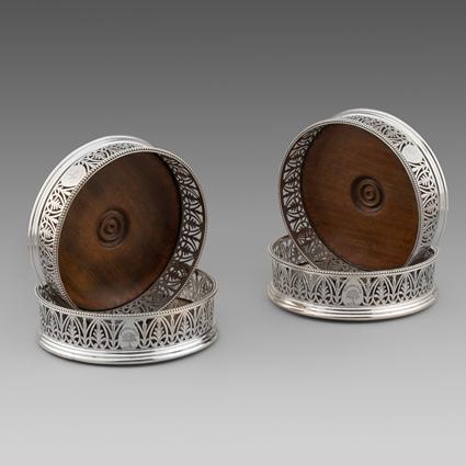 A Set of Four Pierced Border Wine Coasters