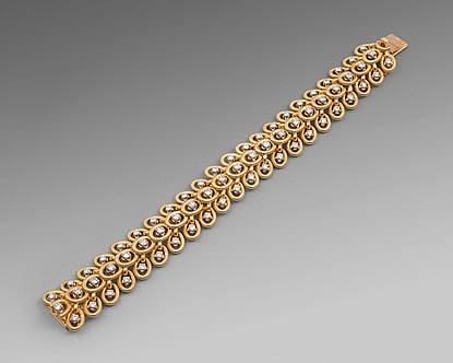 A Gold & Diamond Strap Bracelet with Interlink Circles