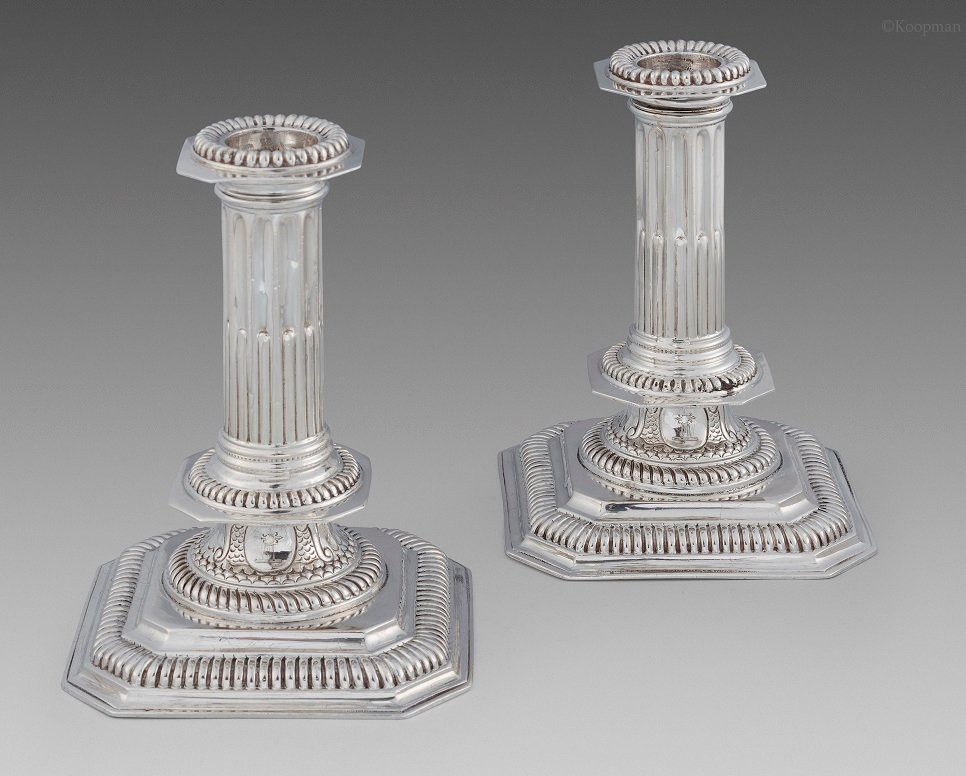 A Pair Of Queen Anne Candlesticks