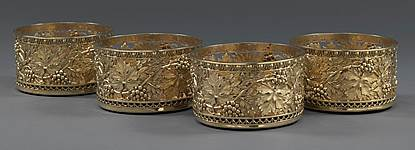A Set of Four George III Silver-Gilt Wine Coasters