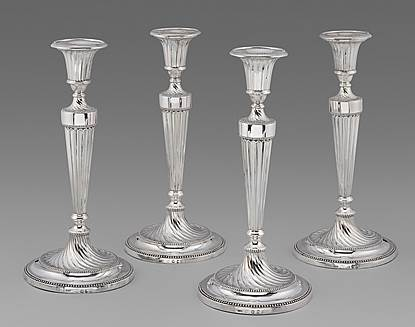 Four Elegant Georgian Neo-Classical Candlesticks