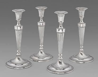 Four Elegant Georgian Neo-Classical Candlesticks