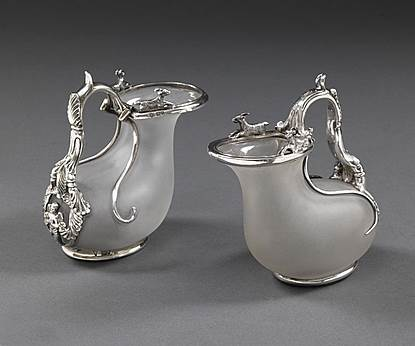 A Pair of Silver-Mounted Ascos Jugs