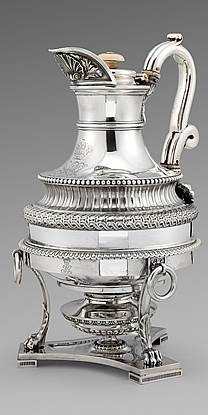 A Fine George III Coffee Pot on burner