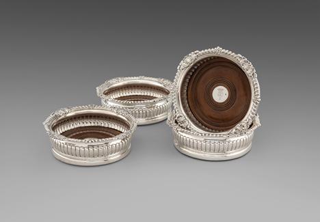 A Rare Set of Four Regency Wine Coasters