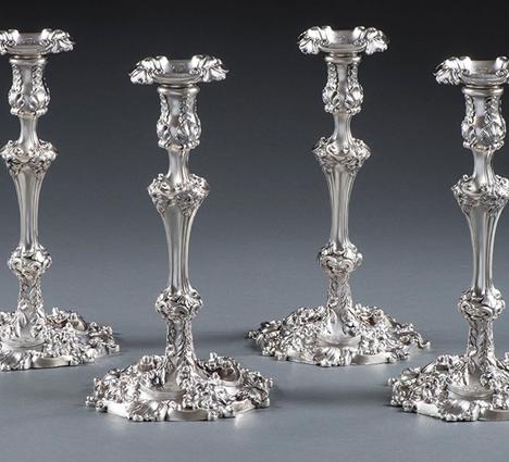 A Set of Four George III Candlesticks