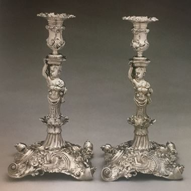 A Highly Important Pair of Figural Candlesticks