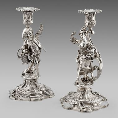 A Pair of Figural Candlesticks