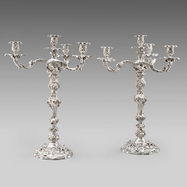 A Pair of Rococo Four-Light Candelabra